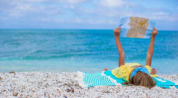 Adorable little girl with map find the way on tropical beach vacation