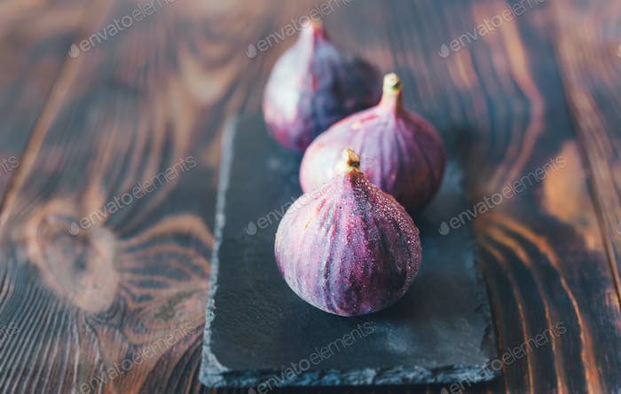 Fresh figs on the stone board