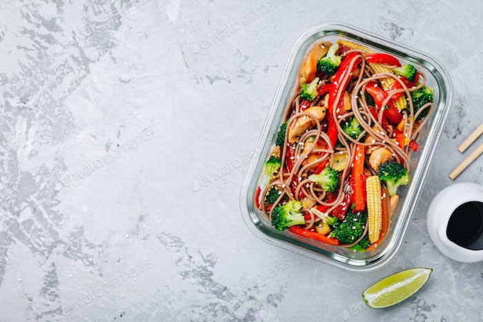 Chicken teriyaki stir fry meal prep containers with broccoli, carrots, rice or soba noodles