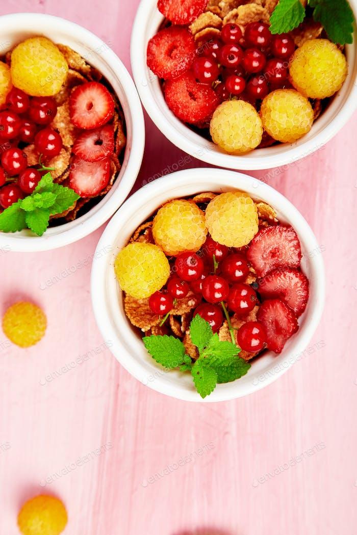 Healthy breakfast on white bowls. Fresh granola,