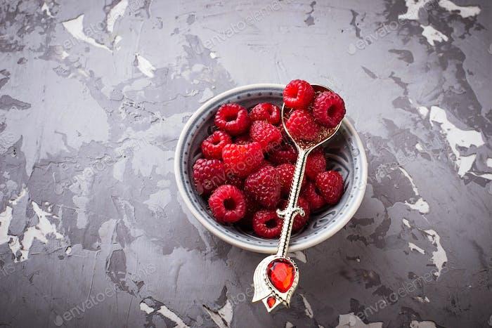 Sweet raspberry on concrete background