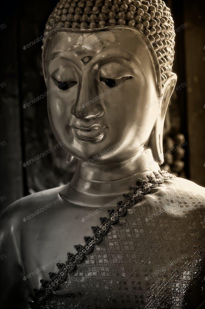 Close-up headshot of Buddha statue