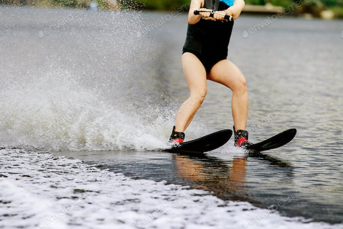 Young woman on water ski