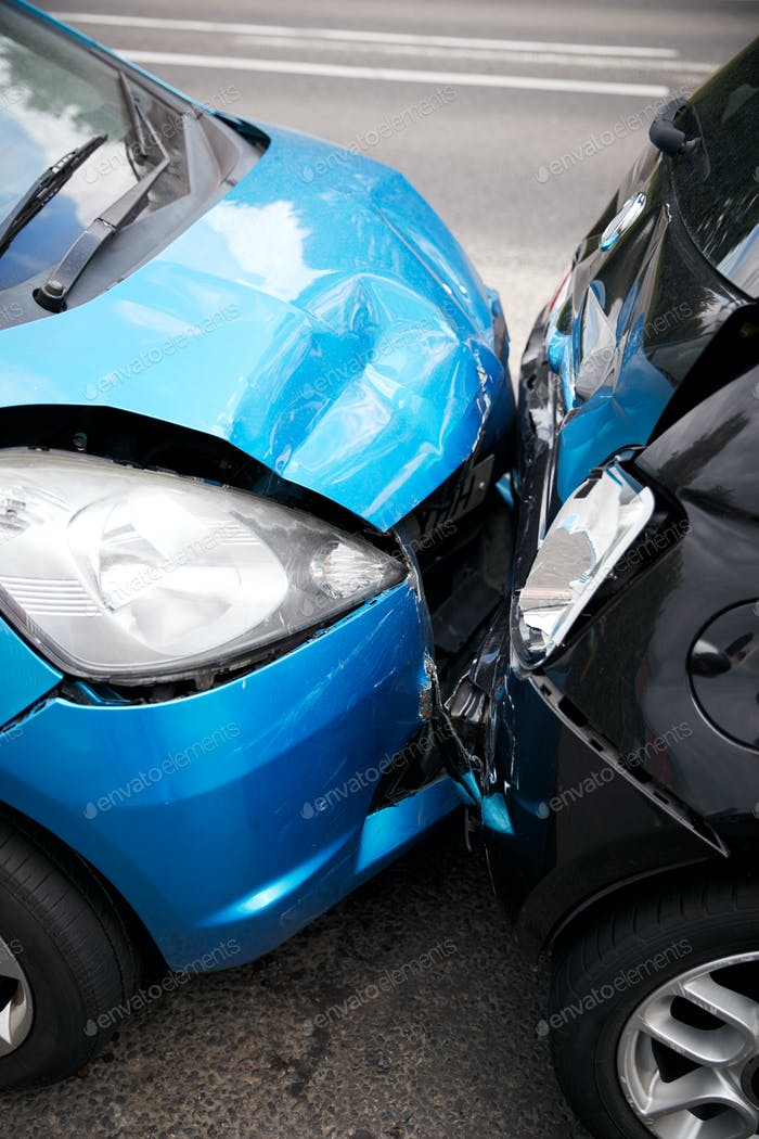 Close Up Of Two Cars Damaged In Road Traffic Accident