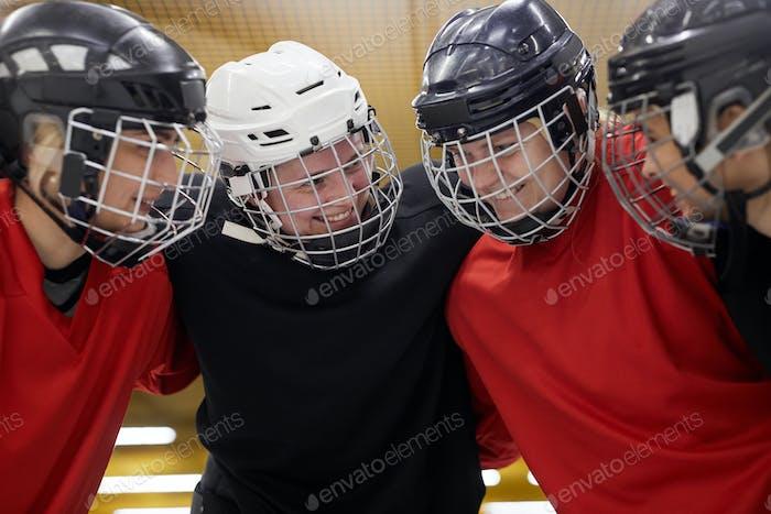 Female Hockey Team Huddling