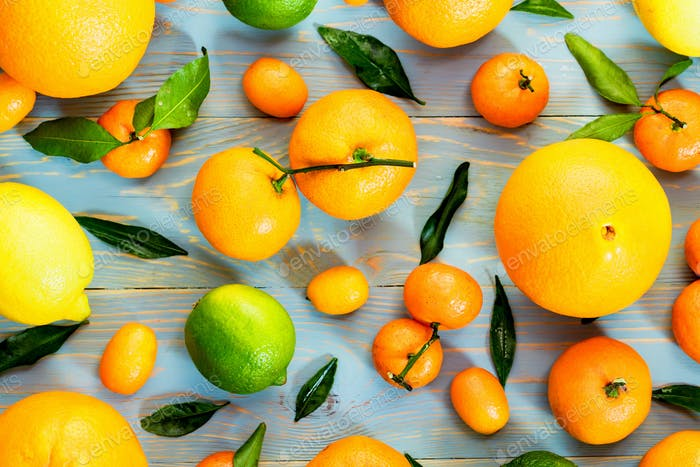 Close-up of various citrus fruits. Top view