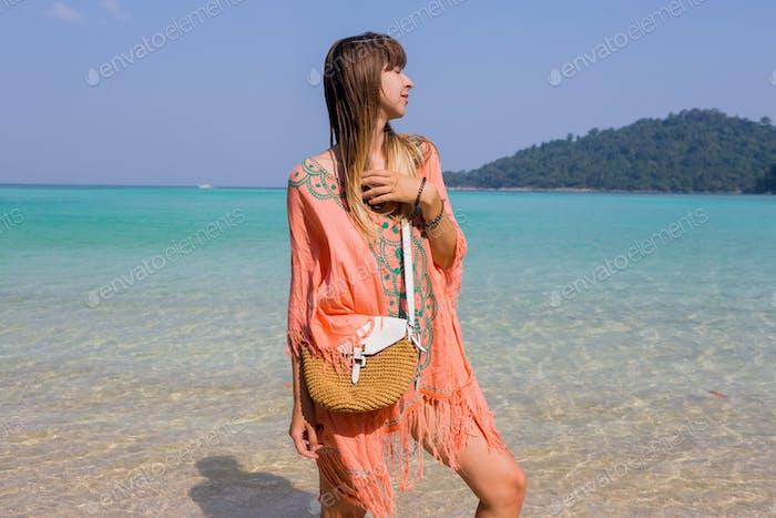 Seductive woman in boho beach dress