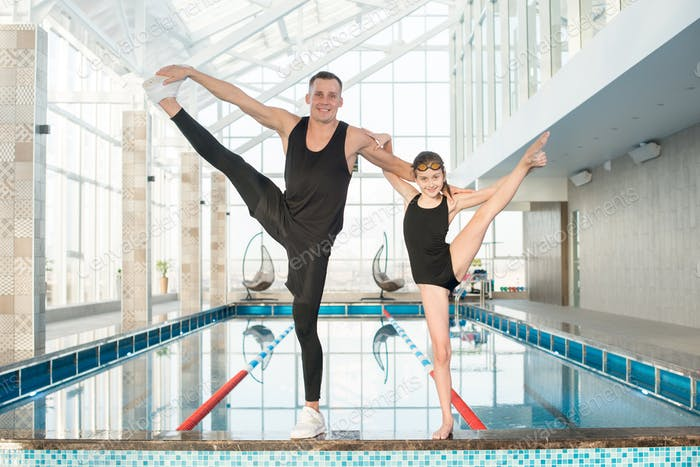 Portrait of Swimming Coach and His Pupil