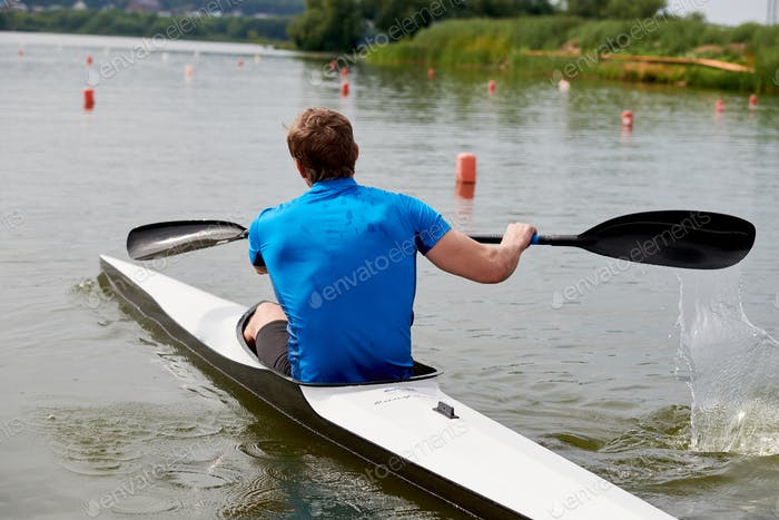 Rower floating in a canoe