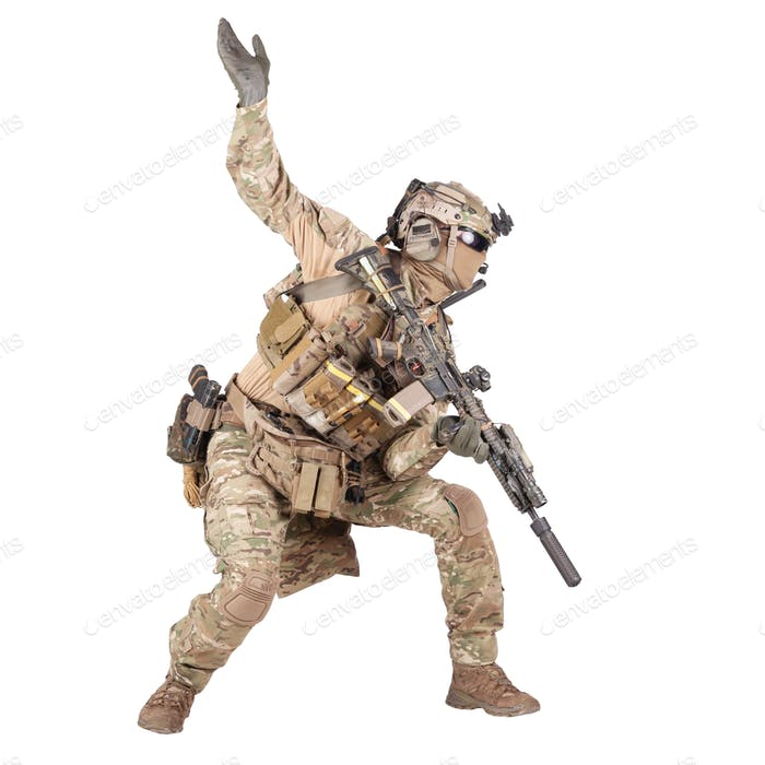 Army soldier going in attack isolated studio shoot