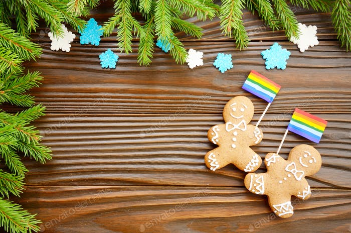 Christmas background of gingerbread man with flag spruce branches and colorful sugar snowflakes