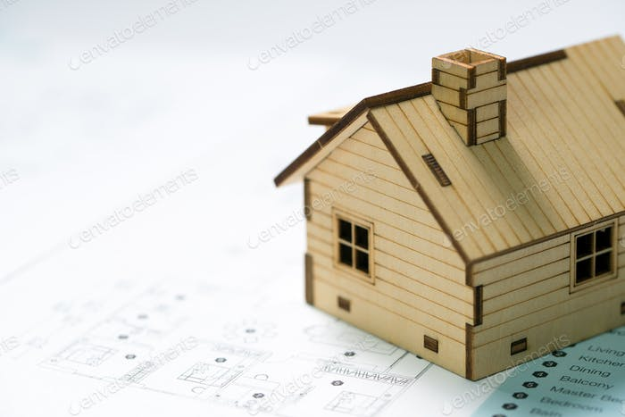 Miniature house model with house layout plan