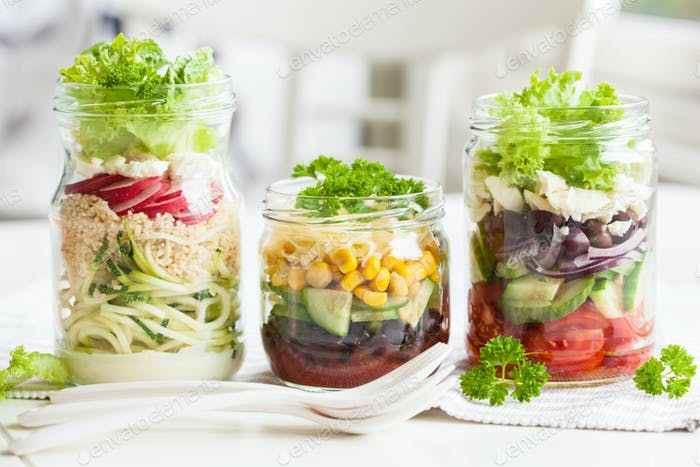healthy vegetable cheese salad in mason jars