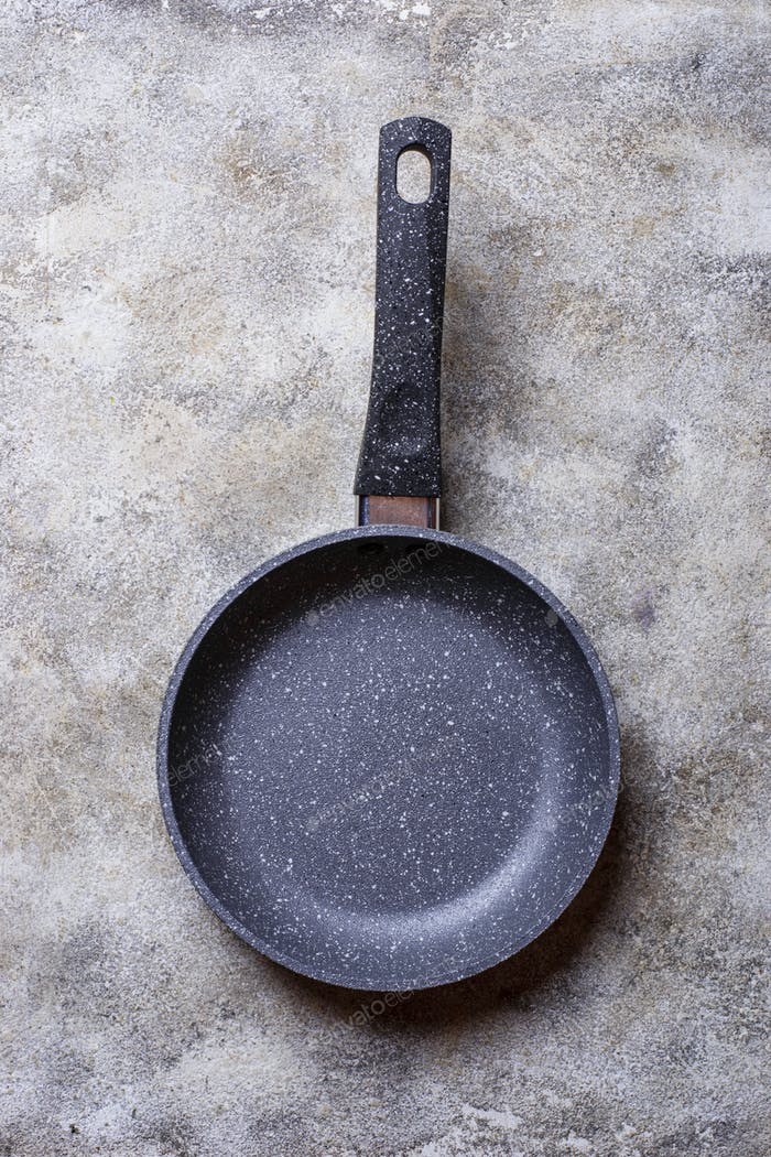 Empty grey stone frying pan
