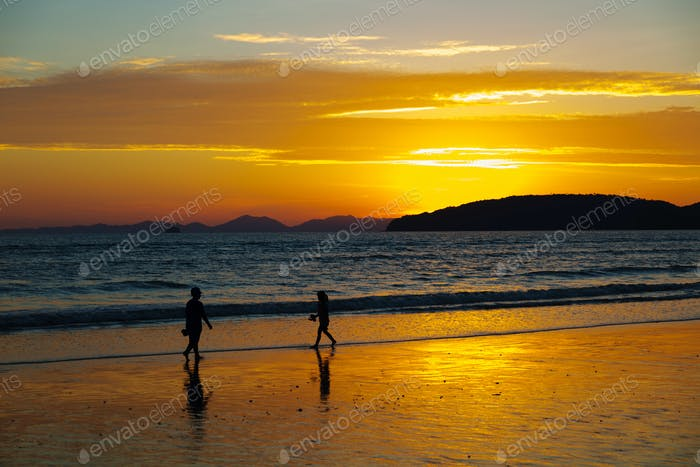 Children Walking At Beach During Sunset