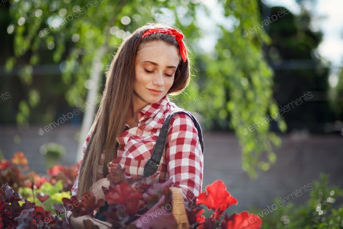 Young woman during shopping at a garden center