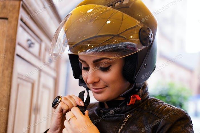 A woman in a moto helmet.