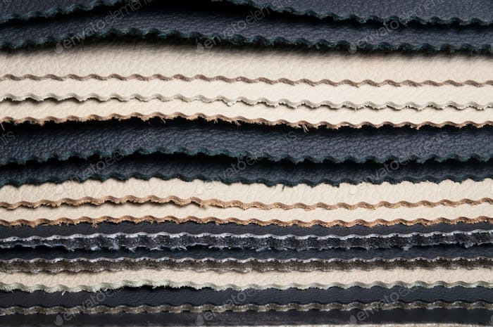 Layers of black and white leather samples