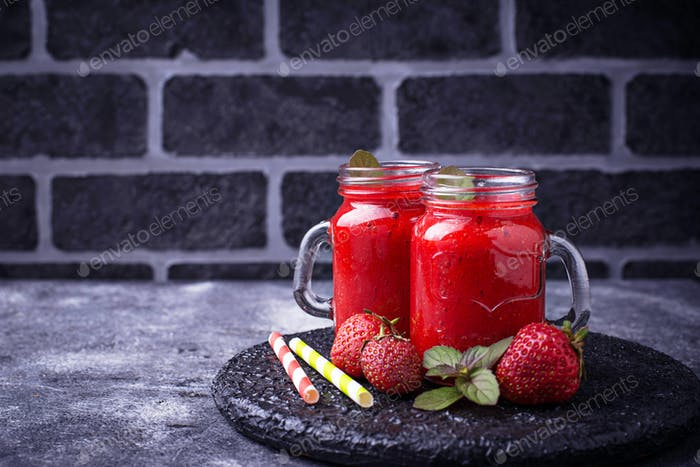 Strawberry smoothie in glass jars