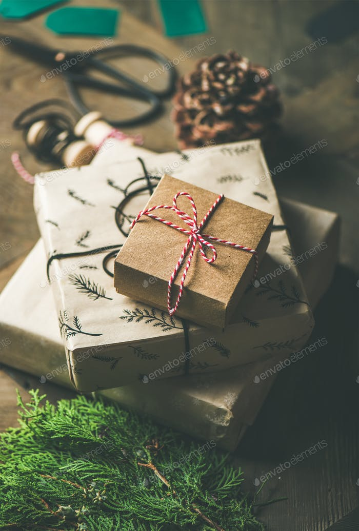 Gift boxes, rope, fur branches, scissors, selective focus
