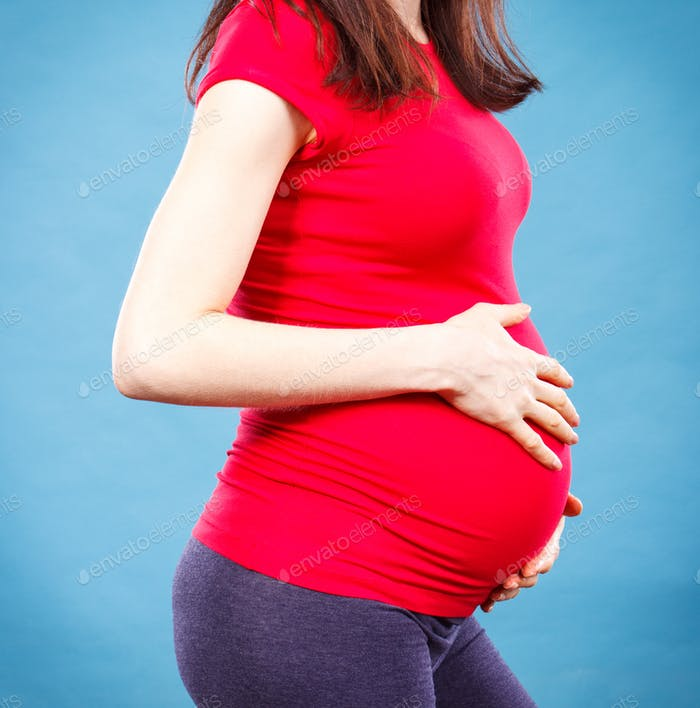 Woman in pregnant touching her belly
