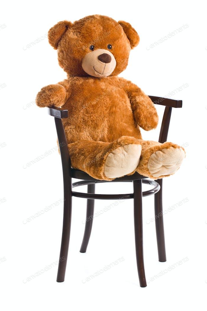 teddy bear sitting on a chair