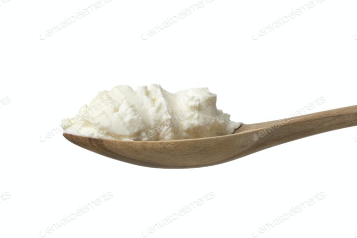 Fresh white cheese, called fromage blanc in France at a wooden s
