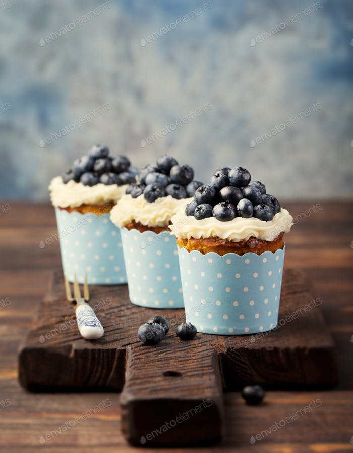 Pumpkin cupcakes, with cream cheese, blueberries