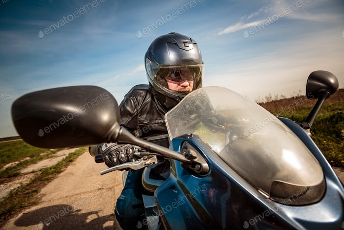 Biker racing on the road