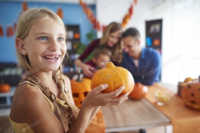 Cute girl with Halloween pumpkin