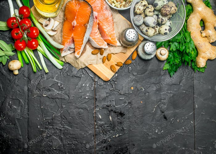 Healthy food. Salmon with vegetables and herbs .