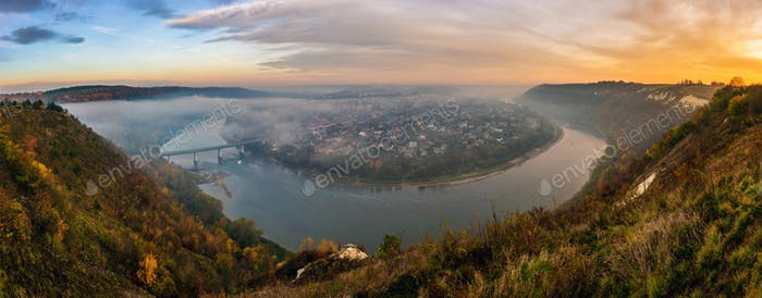 Panoramic view on Zalishchyky city and Dniester river meander and canyon at dawn