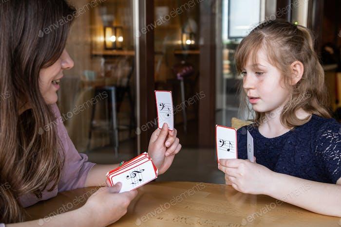 Music theory lesson, solfeggio using educational flashcards.
