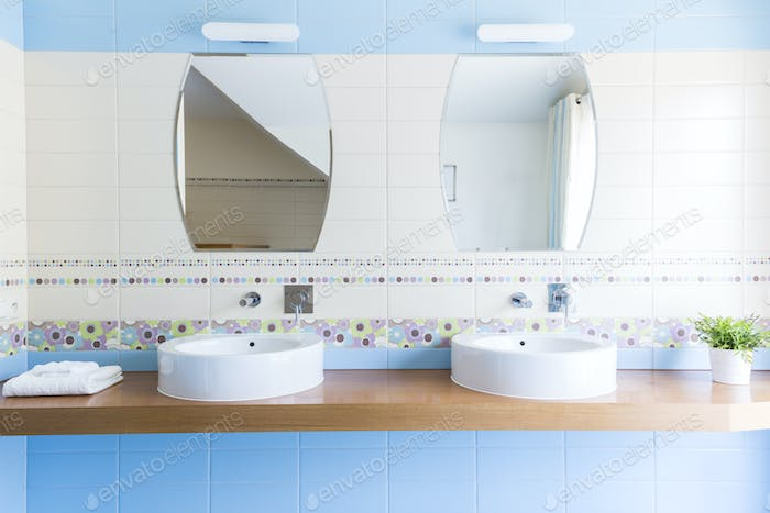Two sinks with mirrors in the minimalist bathroom