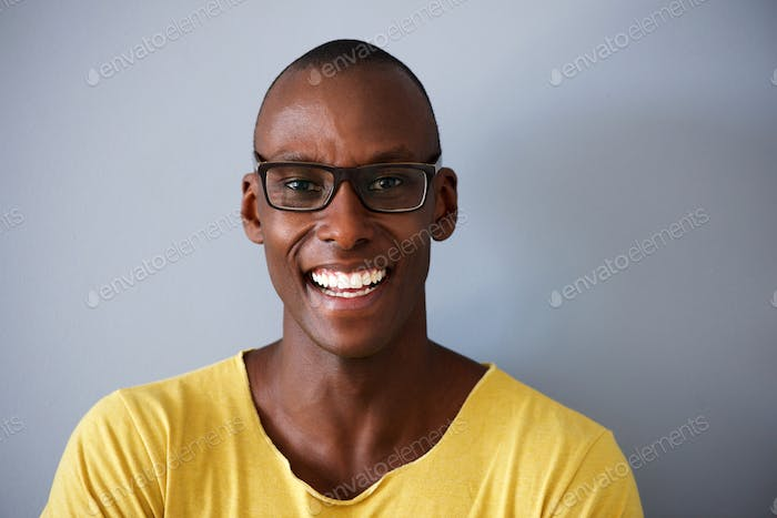 Close up smiling african american man against gray background