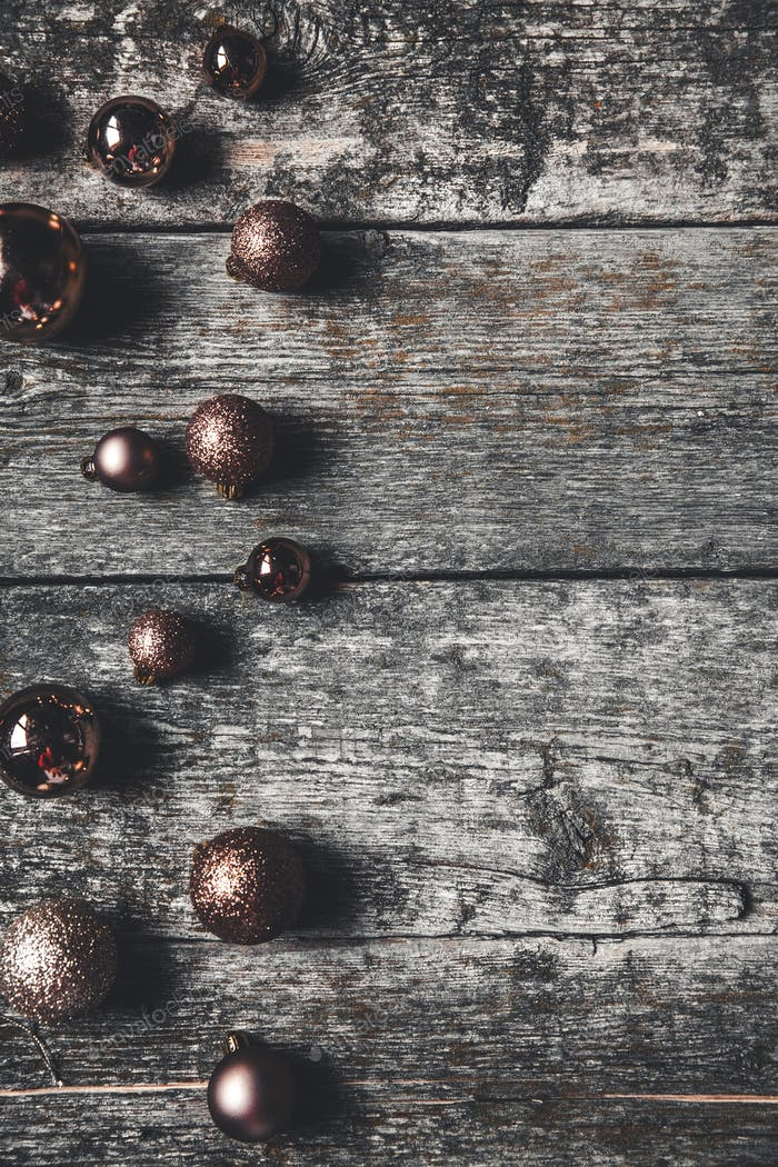 Christmas or New Year background. Vintage Christmas tree toy decoration balls over wooden background
