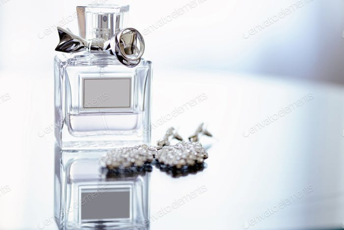 Beautiful wedding rings and perfume bottle for bride and groom