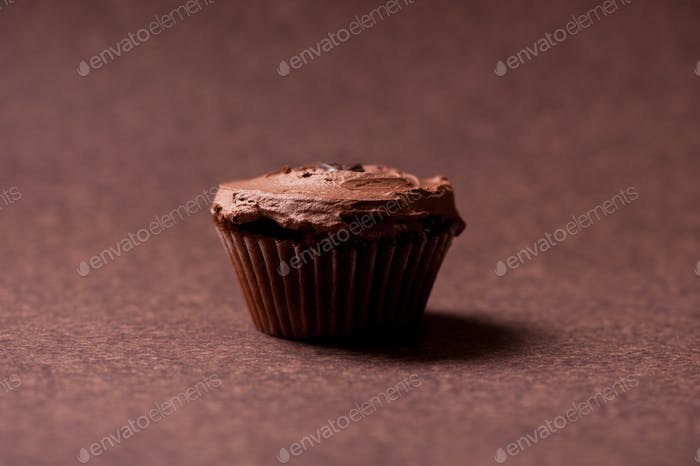 Sweet and creamy chocolate muffin or cupcake at restaurant