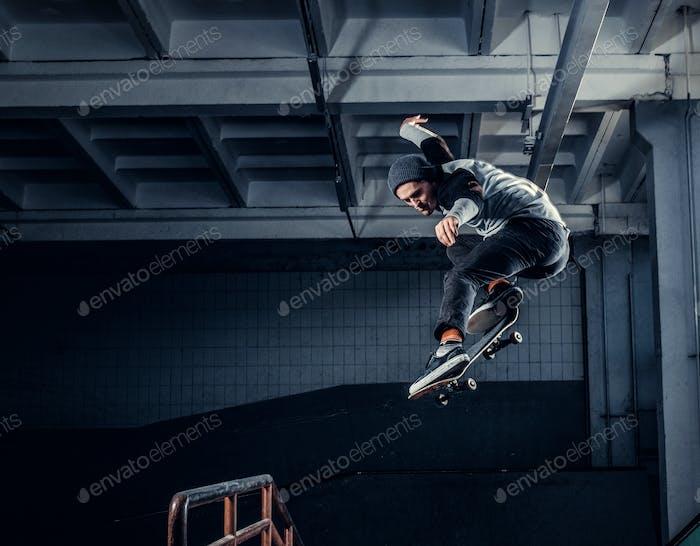 Young skateboarder at skate park indoor