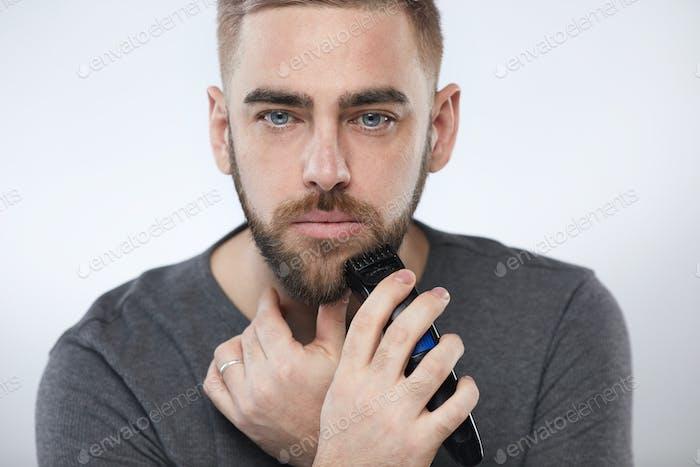 Man Grooming Beard Portrait