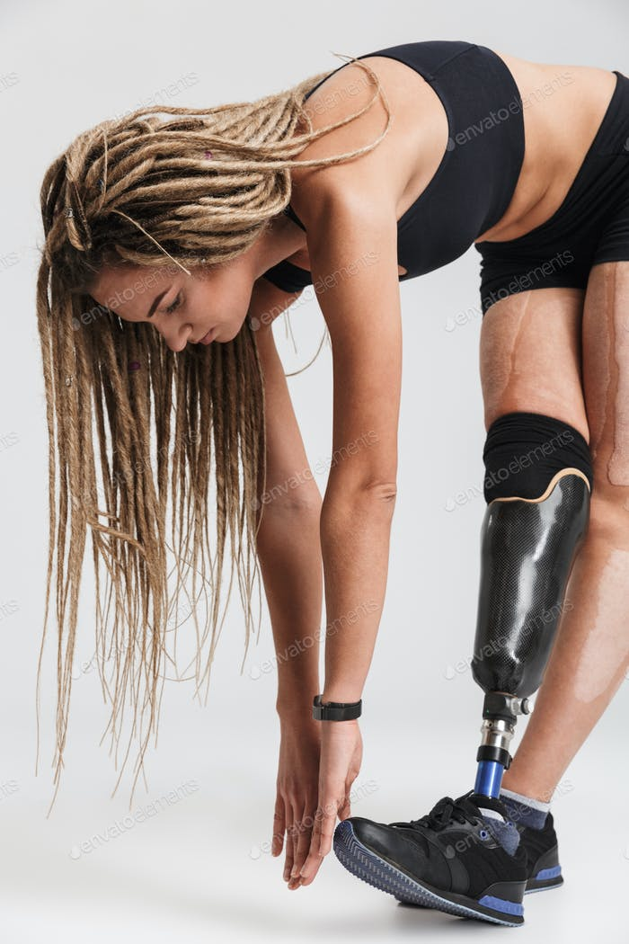Amazing healthy young disabled sportswoman make exercises.
