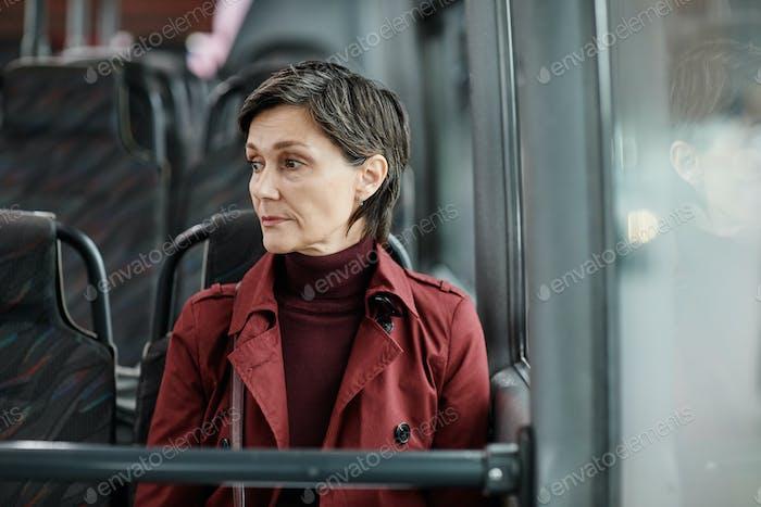 Pensive Woman on Bus