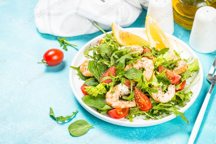 Shrimp salad with vegetables and leaves