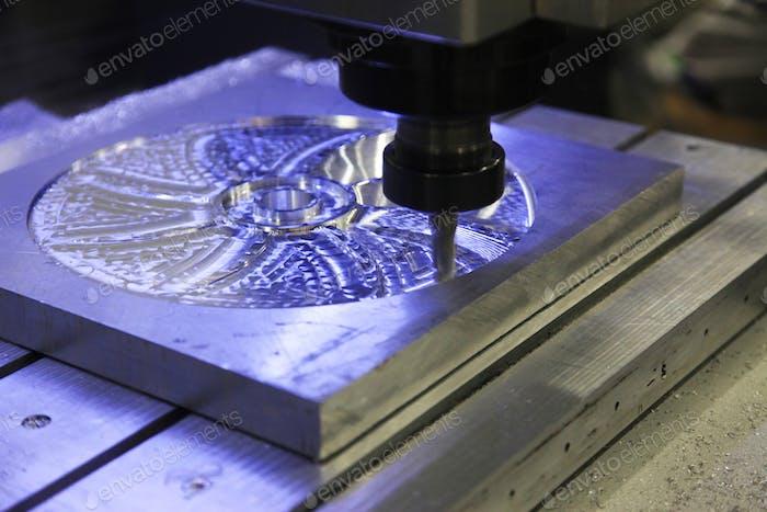 Industrial metal mold/blank milling.