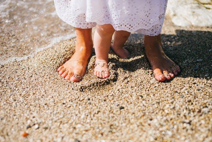 mother with children travel beach