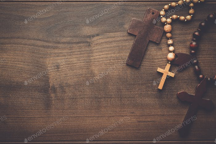crosses over brown wooden background