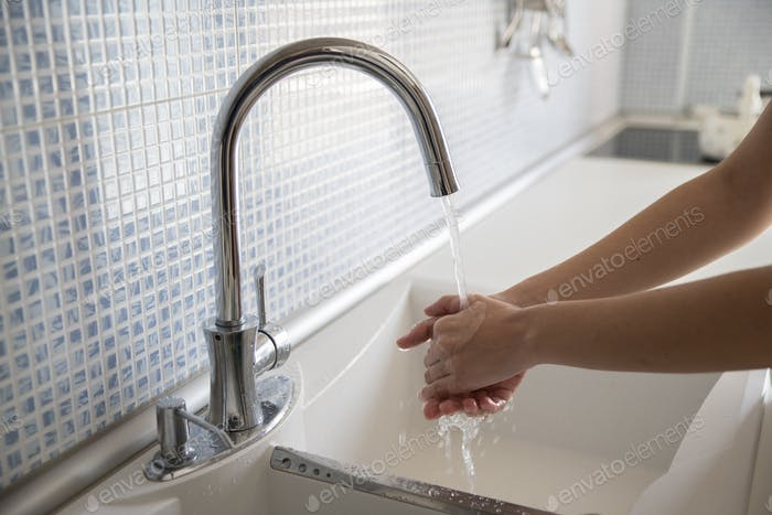 Woman washing her hands with soap, corona virus