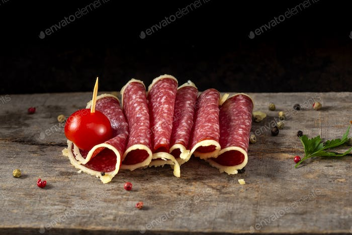 Slices of salami surrounded by parmesan cheese