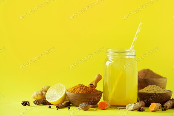 Lemon water with ginger, curcuma, black pepper. Vegan hot drink concept. Ingredients for orange