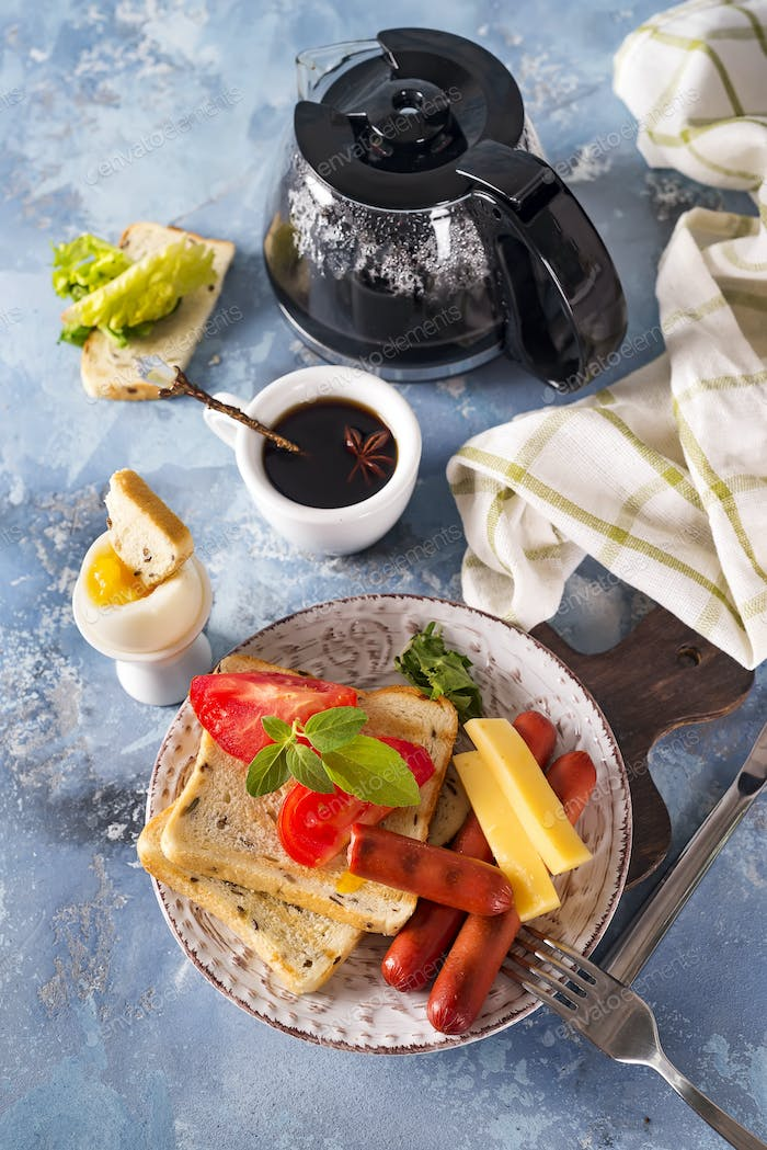 Thumbnail for English breakfast. Fried eggs, sausages, toasts, tomatoes on stone table.
